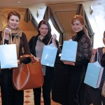 A group of satisfied customers with their gift bags